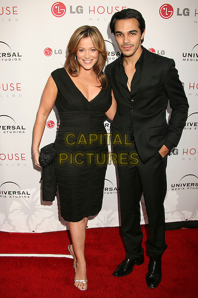 SHALIM ORTIZ & GUEST.Universal Media Studios Emmy Party at LG House, Malibu, California, USA..August 2nd, 2007.full length black dress suit hand in pocket.CAP/ADM/BP.©Byron Purvis/AdMedia/Capital Pictures