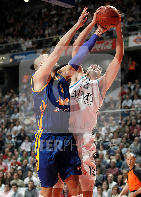 Real Madrid's Nikola Mirotic (r) and BC Khimki MR's James Augustine during Euroleague 2012/2013 match.November 23,2012. (ALTERPHOTOS/Acero)