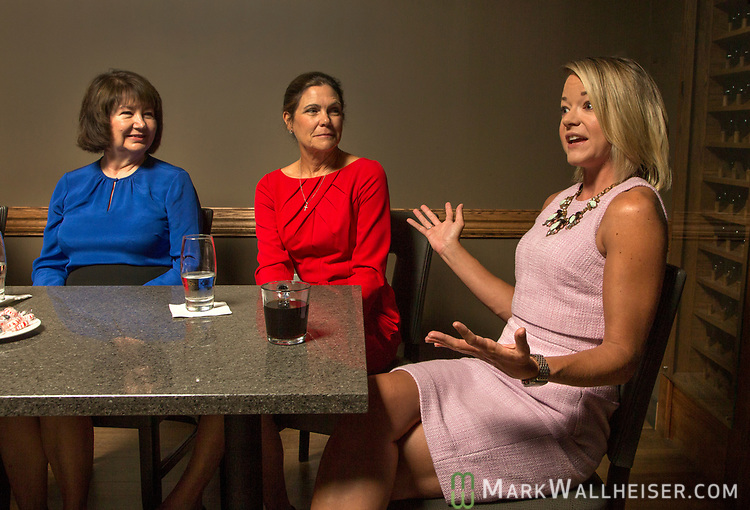 Lobbyist Keyna Cory, left, and Jan Gorrie listen as Sarah Busk talks during a Florida Women Lobbyist round table at the Blue Halo Restaurant in Tallahassee, Florida.