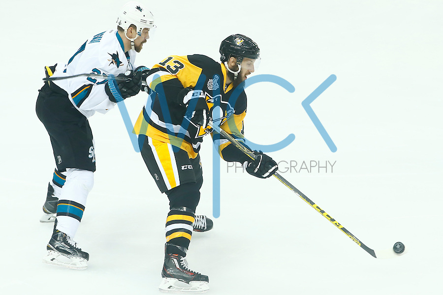 Nick Bonino #13 of the Pittsburgh Penguins skates past Joonas Donskoi #27 of the San Jose Sharks in the first period during game two of the Stanley Cup Final at Consol Energy Center in Pittsburgh, Pennslyvania on June 1, 2016. (Photo by Jared Wickerham / DKPS)