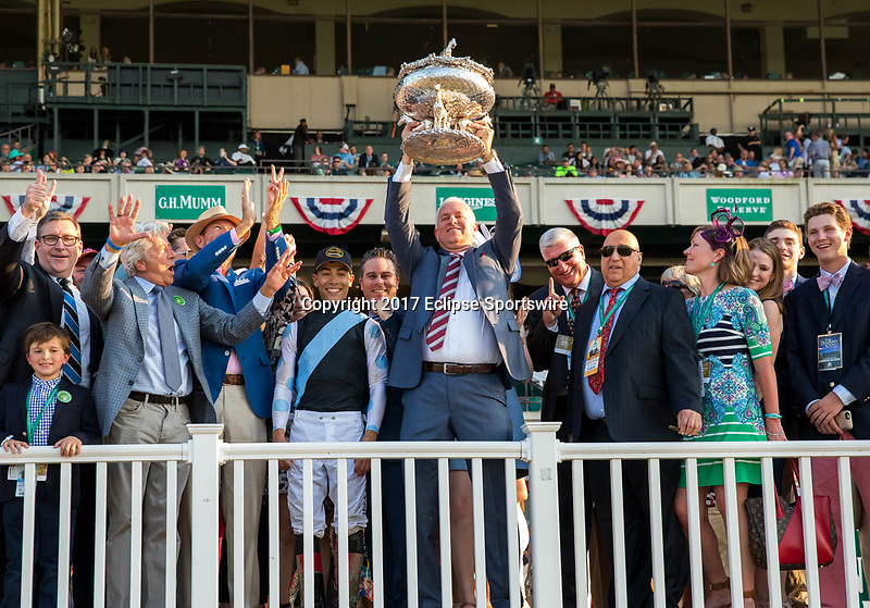 ELMONT, NY - JUNE 10: Tapwrit trainer Todd Pletcher holds up the trophy after winning the 149th Belmont Stakes  on Belmont Stakes Day at Belmont Park on June 10, 2017 in Elmont, New York (Photo by Jesse Caris/Eclipse Sportswire/Getty Images)