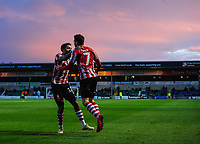 Lincoln City's Tom Pett, right, celebrates scoring his side's second goal with team-mate Bruno Andrade<br /> <br /> Photographer Chris Vaughan/CameraSport<br /> <br /> Emirates FA Cup First Round - Lincoln City v Northampton Town - Saturday 10th November 2018 - Sincil Bank - Lincoln<br />  <br /> World Copyright © 2018 CameraSport. All rights reserved. 43 Linden Ave. Countesthorpe. Leicester. England. LE8 5PG - Tel: +44 (0) 116 277 4147 - admin@camerasport.com - www.camerasport.com