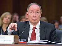 """United States Army General (Retired) Keith B. Alexander, former Director, National Security Agency (DIRNSA), former Chief of the Central Security Service (CHCSS) and former Commander of the United States Cyber Command, and current Chief Executive Officer and President, IronNet Cybersecurity, testifies before the US Senate Select Committee on Intelligence conducting an open hearing titled """"Disinformation: A Primer in Russian Active Measures and Influence Campaigns"""" on Capitol Hill in Washington, DC on Thursday, March 30, 2017. Photo Credit: Ron Sachs/CNP/AdMedia"""