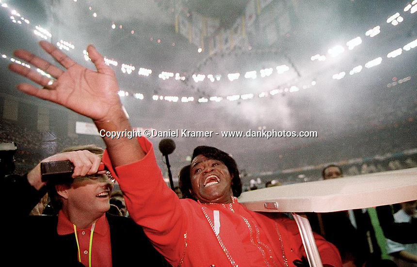 James Brown leaves the stage after entertaining the crowd at Super Bowl XXXI in the Superdome in New Orleans on January 26, 1997.