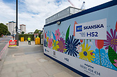 Costain Skanska hoarding in Hampstead Road, Euston, around a demolition and construction site for the London terminal of the HS2 high speed train line, London.