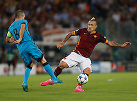 Barcellona's Andreas Iniesta fight for the ball with  AS Roma's Radja Nainggolan  during the Champions League Group E soccer match   at the Olympic Stadium in Rome September 16, 2015