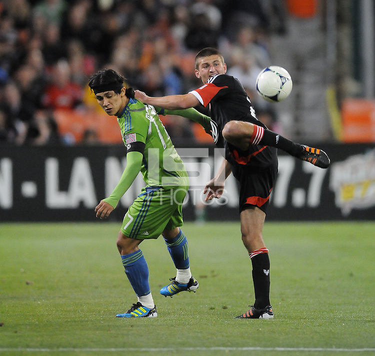 D.C. United midfielder Perry Kitchen (23) fights for possession of the ball against Seattle Sounder forward Freddy Montero (17)  D.C. United tied The Seattle Sounders 0-0 at RFK Stadium, Saturday April 7 , 2012.