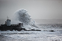 WEATHER PICTURE WALES<br /> Pictured: Waves crash against the promenade wall and the lighthouse in the seaside town of Porthcawl, south Wales, UK. Wednesday 03 January 2018<br /> Re: Storm Eleanor affects parts of the UK.