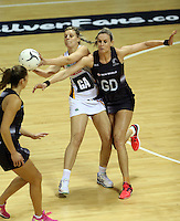 28.07.2015 Silver Ferns Leana de Bruin and South Africa's Maryka Holtzhausen in action during the Silver Fern v South Africa netball test match played at Trusts Arena in Auckland. Mandatory Photo Credit ©Michael Bradley.