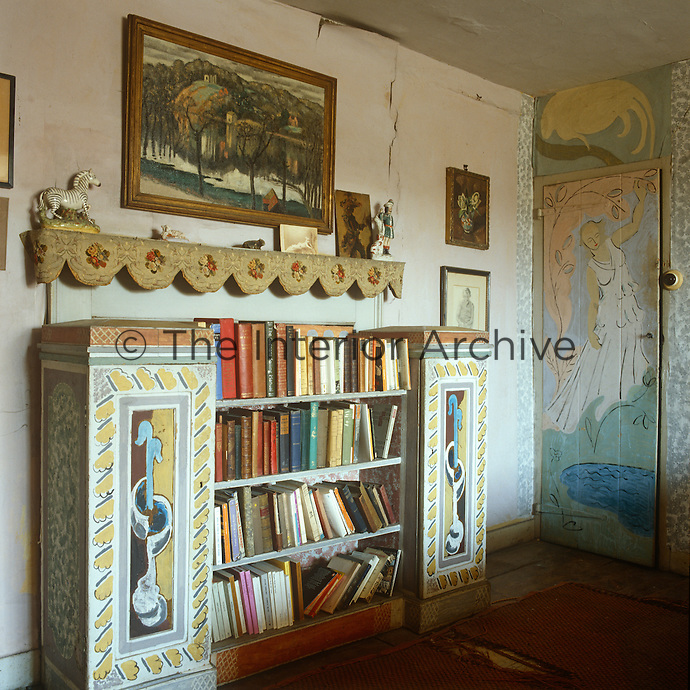 A hand-painted bookcase is just one of many pieces of imaginative pieces of furniture at Monk's House