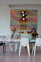 Karim Rashid and his wife Ivana sitting at the dining table in their New York apartment