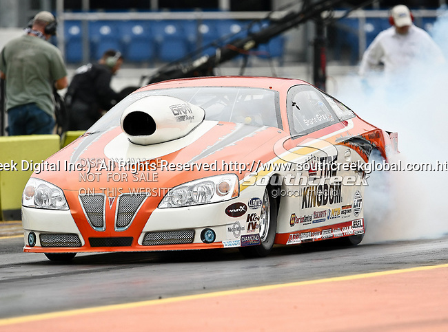 Shane Gray #730, driver for Tire Kingdom's Pro Stock Car heats up his tires at the O'Reilly Fall Nationals held at the Texas Motorplex in  Ennis, Texas.
