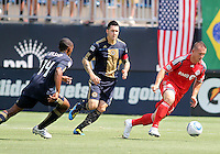 Danny Califf #4 and Amobi Okugo #14 of the Philadelphia Union chase after Chad Barrett #19 of Toronto FC during an MLS match at PPL stadium in Chester, PA. on July 17 2010. Union won 2-1.