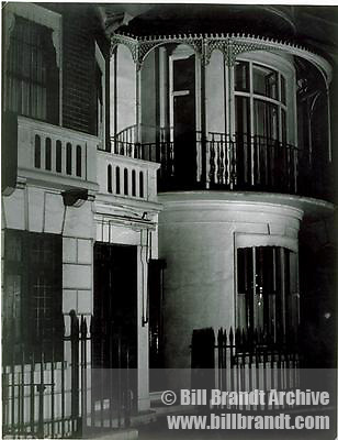 Georgian townhouses with curved fronts at night 1940s