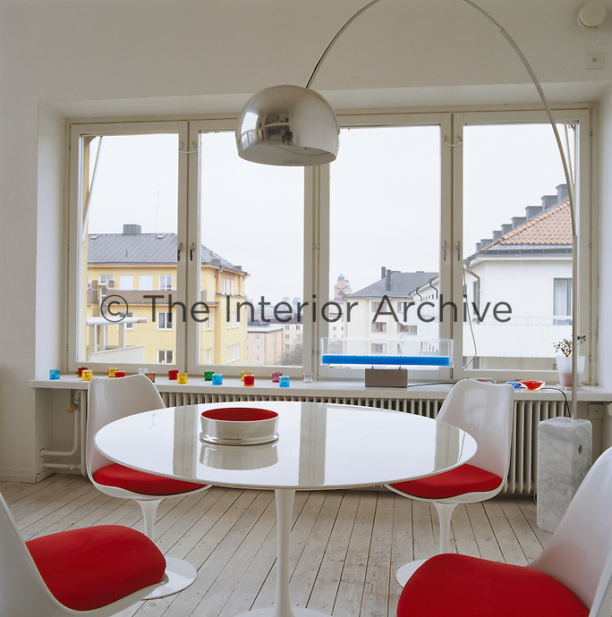 A Tulip Dining Table And Chairs By Eero Saarinen An Arc Floor Lamp Castiglioni
