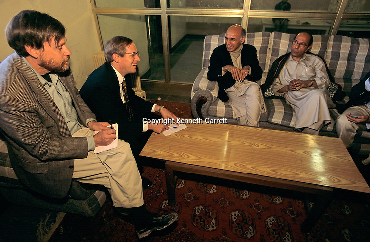 Fredrik Hiebert, National Geographic Fellow and others meet with Sayed Raheen, Afghanistan's Minister of Culture, and Minister of Finance (left on sofa) to discuss Bactrian gold find, Kabul, Afghanistan