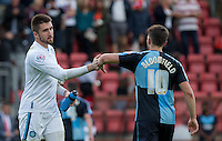 Goalkeeper Matt Ingram of Wycombe Wanderers & goal scorer Matt Bloomfield of Wycombe Wanderers at the final whistle during the Sky Bet League 2 match between Leyton Orient and Wycombe Wanderers at the Matchroom Stadium, London, England on 19 September 2015. Photo by Andy Rowland.