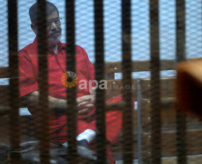 Ousted Egyptian president Mohammed Morsi sits behind bars during his trail in a court in Cairo on August 30, 2015. Cairo criminal court resumes today the trial of deposed president Mohamed Morsi and 10 others on charges of espionage and leaking classified documents related to the national security and the army to Qatar. Photo by Amr Sayed