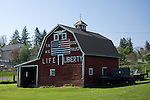 "Washington, Latah.  A patriotic painted red barn declares ""In God we Trust"" ""Life n Liberty"" in the small farming community of Latah."
