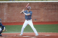 Anthony Stehlin (12) of the Concord Mountain Lions at bat against the Wingate Bulldogs at Ron Christopher Stadium on February 1, 2020 in Wingate, North Carolina. The Bulldogs defeated the Mountain Lions 8-0 in game one of a doubleheader. (Brian Westerholt/Four Seam Images)