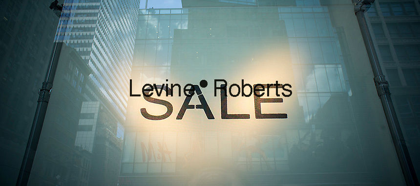 Minimalist sale sign in the window of a Zara store on Fifth Avenue in New York on Friday, June 28, 2013. (© Richard B. Levine)