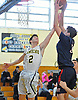Michael Gannon #34 of Smithtown West, right, and Aaron Jaffee #2 of Jericho go up for a rebound during a non-league game in the Richard Brown Nassau-Suffolk Challenge at Uniondale High School on Saturday, Jan. 14, 2017. Smithtown West won by a score of 56-45.