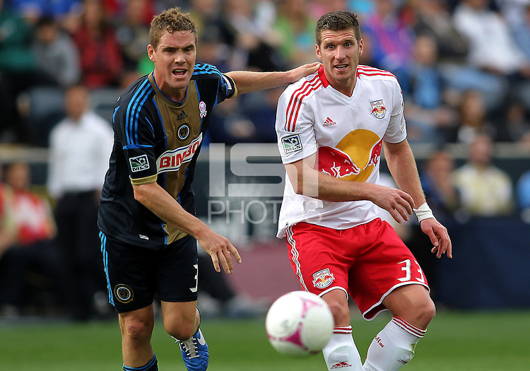 CHESTER, PA - OCTOBER 27, 2012:  Chris Albright (3) of the Philadelphia Union and  Kenny Cooper (33) of the New York Red Bulls watch the ball during an MLS match at PPL Park in Chester, PA. on October 27. Red Bulls won 3-0.