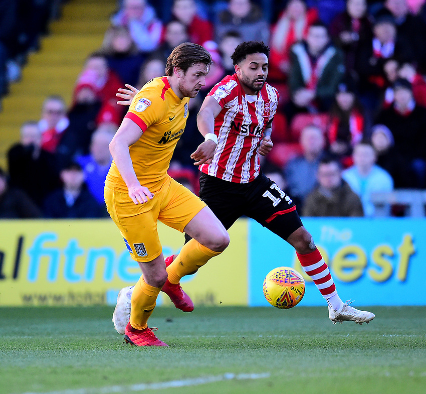Lincoln City's Bruno Andrade vies for possession with  Northampton Town's Ash Taylor<br /> <br /> Photographer Andrew Vaughan/CameraSport<br /> <br /> The EFL Sky Bet League Two - Lincoln City v Northampton Town - Saturday 9th February 2019 - Sincil Bank - Lincoln<br /> <br /> World Copyright © 2019 CameraSport. All rights reserved. 43 Linden Ave. Countesthorpe. Leicester. England. LE8 5PG - Tel: +44 (0) 116 277 4147 - admin@camerasport.com - www.camerasport.com