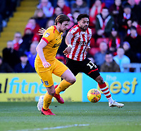 Lincoln City's Bruno Andrade vies for possession with  Northampton Town's Ash Taylor<br /> <br /> Photographer Andrew Vaughan/CameraSport<br /> <br /> The EFL Sky Bet League Two - Lincoln City v Northampton Town - Saturday 9th February 2019 - Sincil Bank - Lincoln<br /> <br /> World Copyright &copy; 2019 CameraSport. All rights reserved. 43 Linden Ave. Countesthorpe. Leicester. England. LE8 5PG - Tel: +44 (0) 116 277 4147 - admin@camerasport.com - www.camerasport.com