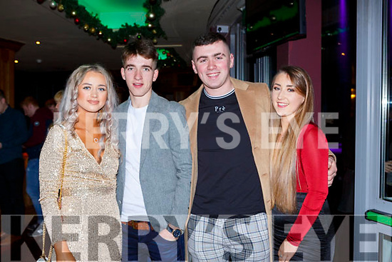 Erica McGuinness, Michael tobin, Con McGrath and Rachel McGrath seeing in New Years Eve in the Snug bar Killarney