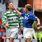 Fernando Ricksen chases Alan Thompson all over the park then gives him a nip on the chin. Celtic v Rangers 27th April 2003