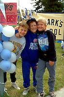 10 year olds taking a break at Catholic school walk a thon fund raiser.  St Paul  Minnesota USA