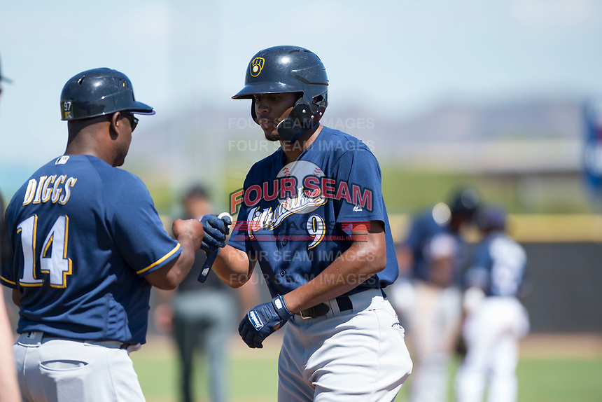 Milwaukee Brewers center fielder Joe Gray (9) is congratulated by first base coach Tony Diggs (14) after a base hit during an Instructional League game against the San Diego Padres at Peoria Sports Complex on September 21, 2018 in Peoria, Arizona. (Zachary Lucy/Four Seam Images)