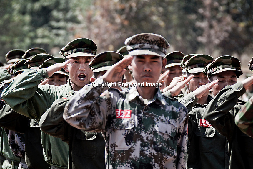 KIA officers perform a military training at the School of Officers situated in a secret location in the high mountains some kilometers away from the Laiza City, the headquarters of the Kachin Independence rebel Army. Fierce clashes have taken place in Kachin State since the ceasefire was broke out by the Burmese army last June 2011. During months the fighting were spread out along the Kachin State leaving more than 40,000 displaced persons and refugees (a conservative estimating) in accord with the humanitarian aid groups.