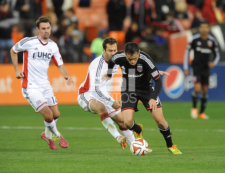 Washington D.C. - April 5, 2014: Fabian Espindola  of D.C. United goes against A.J. Soares from the New England Revolution.  D.C. United defeated 2-0 the New England Revolution during a Major League Soccer match for the 2014 season at RFK Stadium.