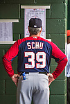12 March 2014: Washington Nationals Batting Coach Rick Schu reads the lineup card in the dugout prior to a Spring Training game against the Houston Astros at Osceola County Stadium in Kissimmee, Florida. The Astros rallied in the bottom of the 9th to edge out the Nationals 10-9 in Grapefruit League play. Mandatory Credit: Ed Wolfstein Photo *** RAW (NEF) Image File Available ***