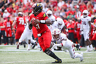 College Park, MD - September 15, 2018:  Maryland Terrapins quarterback Kasim Hill (11) gets sack by a Temple Owls defender during the game between Temple and Maryland at  Capital One Field at Maryland Stadium in College Park, MD.  (Photo by Elliott Brown/Media Images International)