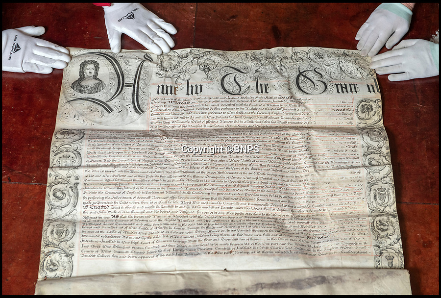 BNPS.co.uk (01202 558833)<br /> Pic: PhilYeomans/BNPS<br /> <br /> Parchment trail - The official deeds from Queen Anne granting the Churchills the land at Blenheim, formerly a Royal hunting lodge.<br /> <br /> The real-life characters behind Olivia Colman's Oscar-tipped film The Favourite have been reunited as part of Blenheim Palace's annual deep clean.<br /> <br /> The portraits of Queen Anne, played by Colman in the film, and Sarah, the first Duchess  of Marlborough, who was portrayed by Rachel Weisz, have been brought together in Blenheim's Great Hall to allow a team of specialist's to undertake the winter clean.<br /> <br /> The film, a historical comedy/drama, depicts the tumultuous relationship between the pair in the early 18th century.<br /> <br /> The land to build Blenheim was gifted to the first Duke and Duchess by Queen Anne after John Churchill's stunning pan-european alliance defeated Louis XIV of France.<br /> <br /> Despite Anne gifting them the land to build the magnificent Palace she also eventually stripped them of their official roles at Court after falling out with strong minded Duchess.