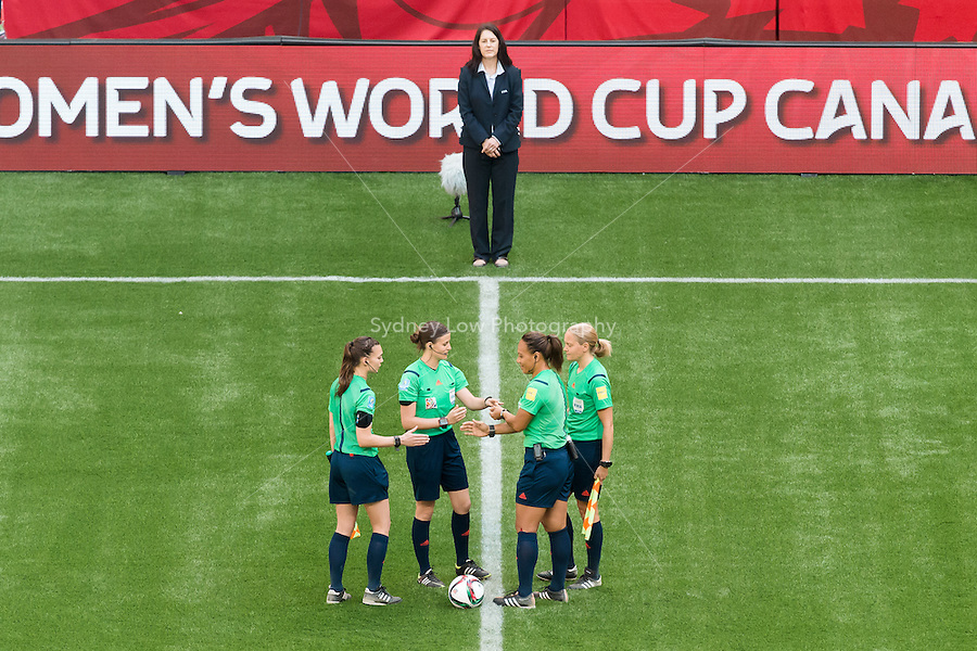 June 8, 2015: Referees prepare for a Group C match at the FIFA Women's World Cup Canada 2015 between Cameroon and Ecuador at BC Place Stadium on 8 June 2015 in Vancouver, Canada. Sydney Low/AsteriskImages