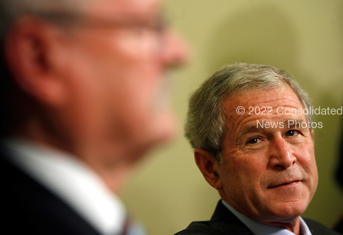 President of the Slovak Republic, Ivan Gasparovic (left) addresses the press while United States President George W. Bush listens after a meeting  in the Oval Office of the White House, in Washington DC, on October 09, 2008.<br /> Credit: Aude Guerrucci / Pool via CNP