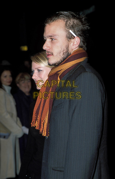 "HEATH LEDGER  .attends the premiere of his new movie ""The Four Feathers"" at the Odeon, West End.sales@capitalpictures.com.www.capitalpictures.com.©Capital Pictures.cigarette behind ear, striped scarf"
