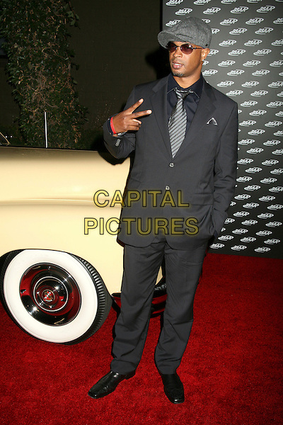 "DAMON WAYANS.Black Sports Agents Association's 10th Anniversary ""Legacy"" Poolside Gala at the Roosevelt Hotel, Hollywood, California, USA..September 24th, 2006.Ref: ADM/BP.full length black suit hat sunglasses shades grey gray hat hand gesture.www.capitalpictures.com.sales@capitalpictures.com.©Byron Purvis/AdMedia/Capital Pictures."