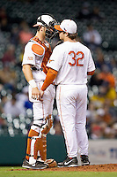 Texas Longhorns catcher Jeremy Montalbano #33 has a chat on the mound with starting pitcher Dillon Peters #32 during the game against the Rice Owls at Minute Maid Park on February 28, 2014 in Houston, Texas.  The Longhorns defeated the Owls 2-0.  (Brian Westerholt/Four Seam Images)