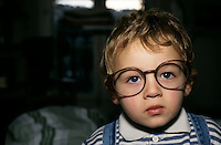 Young boy wearing oversized glasses.