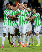 MEDELLÍN -COLOMBIA-29-10-2014. Alejandro Bernal (segundo desde la Izq) jugador de Atlético Nacional de Colombia celebra un gol anotado a Cesar Vallejo de Perú durante juego de ida de los cuartos de final en la Copa Total Sudamericana 2014 realizado en el estadio Atanasio Girardot de Medellín./ Alejandro Bernal (second from L) player of Atletico Nacional of Colombia celebrates a goal scored to Cesar Vallejo of Peru during the first leg match for the quarter finals of the Copa Total Sudamericana 2014 played at Atanasio Girardot stadium in Medellin. Photo: VizzorImage/Luis Ríos/STR