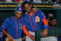 St. Lucie Mets Amed Rosario (back) photo bombs Jhoan Urena (left) and Adrian Abreu (right) before a game against the Bradenton Marauders on April 11, 2015 at McKechnie Field in Bradenton, Florida.  St. Lucie defeated Bradenton 3-2.  (Mike Janes/Four Seam Images)