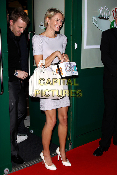 JENNI FALCONER.Leaving the Central Perk Party to launch the 'Friends' DVD, London, England. .September 23rd, 2009 .full length jenny purple lilac dress white handbag purse shoes dvd box set goody funny .CAP/AH.©Adam Houghton/Capital Pictures.