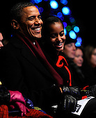 United States President Barack Obama and daughter Malia participate in the 2011 National Christmas Tree Lighting on the Ellipse in Washington, DC, on Thursday, December 1, 2011..Credit: Roger L. Wollenberg / Pool via CNP