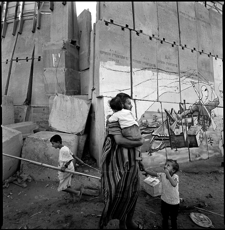 khan Younes, Gaza strip, Sept 13 2005.Palestinians celebrate the end of the Israeli occupation. passing by the former separation wall between Khan Younes and Neve Dekalim.