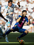 Sergio Ramos (L) of Real Madrid battles for the ball with Luis Alberto Suarez Diaz of FC Barcelona during the La Liga 2017-18 match between Real Madrid and FC Barcelona at Santiago Bernabeu Stadium on December 23 2017 in Madrid, Spain. Photo by Diego Gonzalez / Power Sport Images